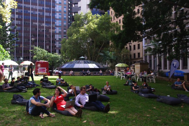 Wynyard station's skylight provides the backdrop in this photo of co-workers loving the shady park