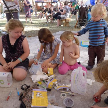 Kids crafting with upcycled materials at wide open space festival