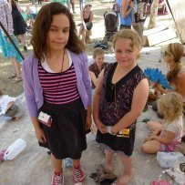 girls show off their upcycled tetra pack bags at wide open space festival