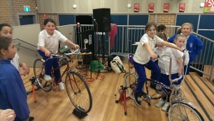 bicycle electricty generating school girls
