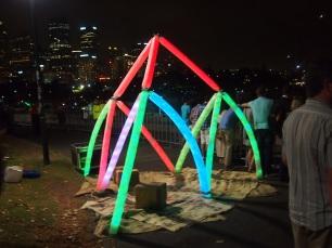 milk bottle light sculpture sydney harbour nye 2013