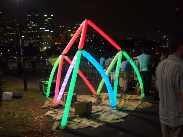 milk bottle light sculpture sydney harbour nye 2013